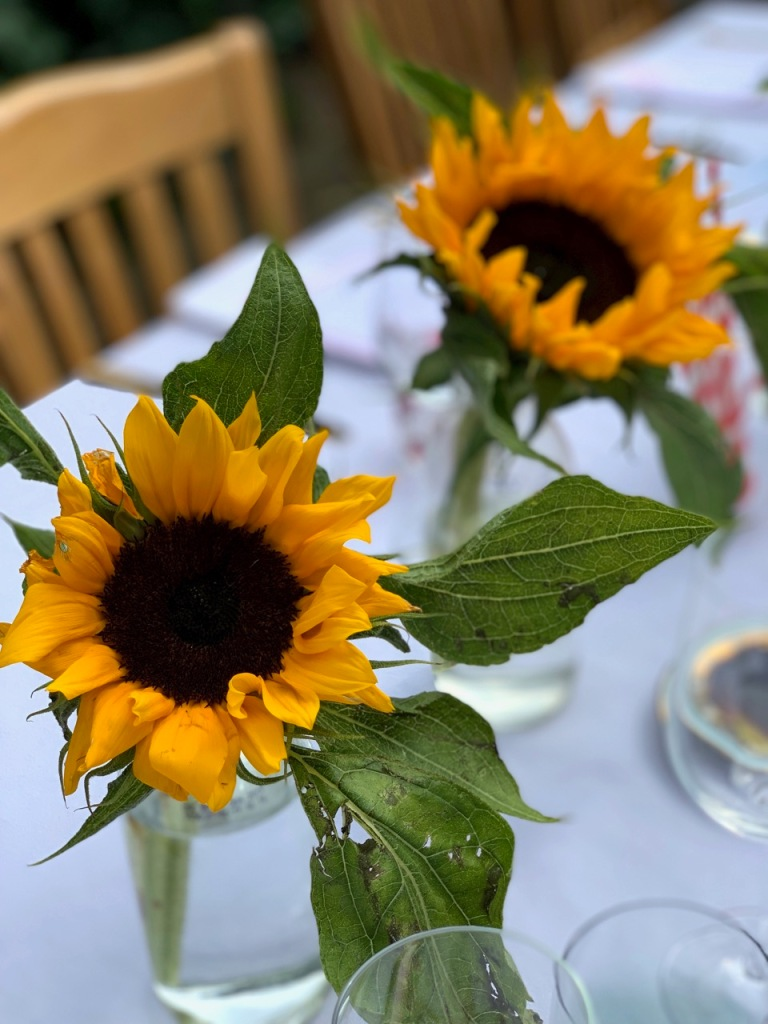 sunflowers used in table setting of brunch supper club