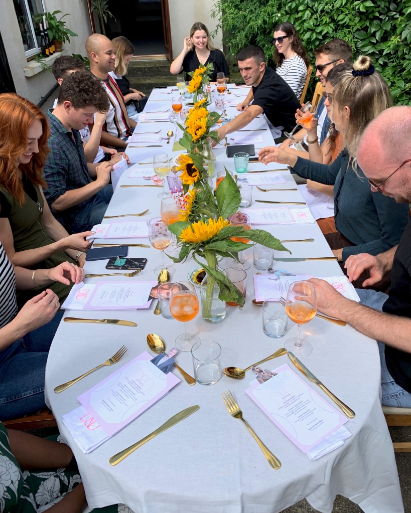 guests sitting at the table enjoying the brunch supper club