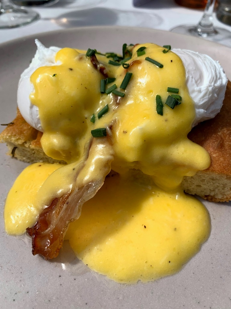 The main of Carbonara Eggs Benedict served at Brunch supper club