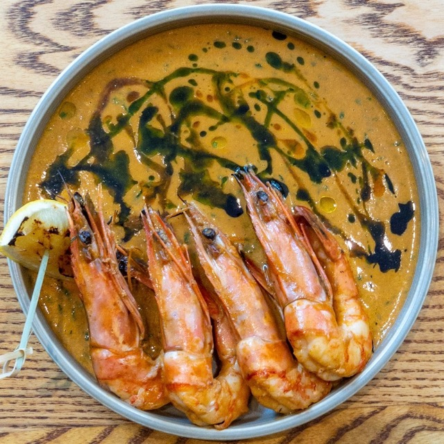 bowl with giant prawns in a creamy sauce