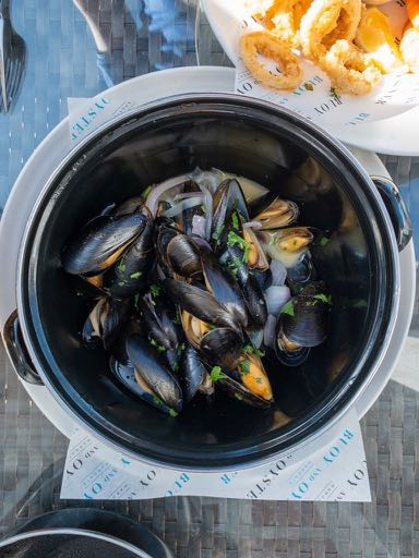 A bowl of mussels in white wine, shallots, parsley and garlic.