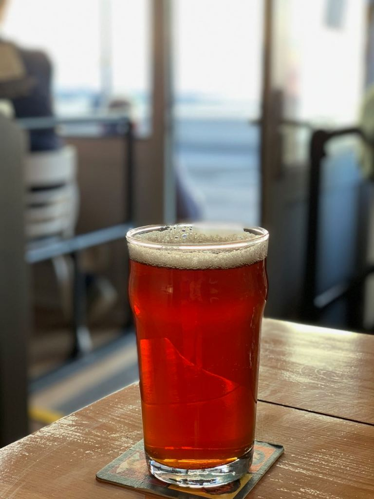 a pint of beer inside the pub.