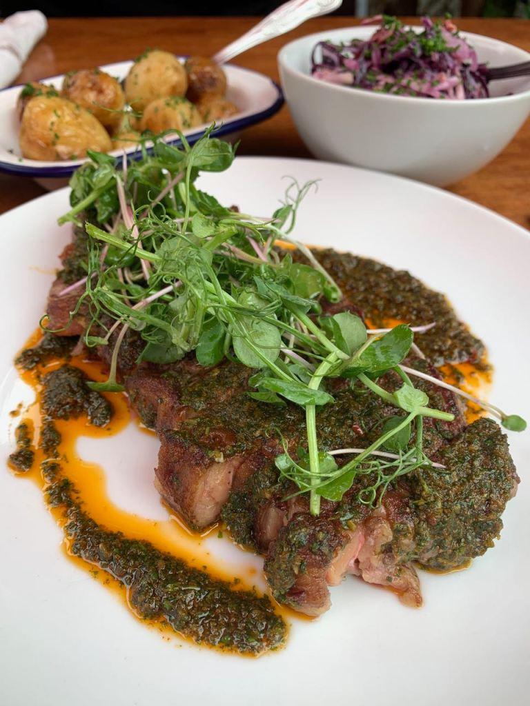 Plate showing Sirloin Steak & Red Chimichurri Sauce