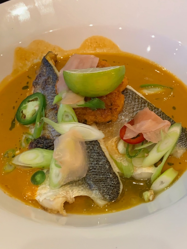 plate with seabass, lime, broth