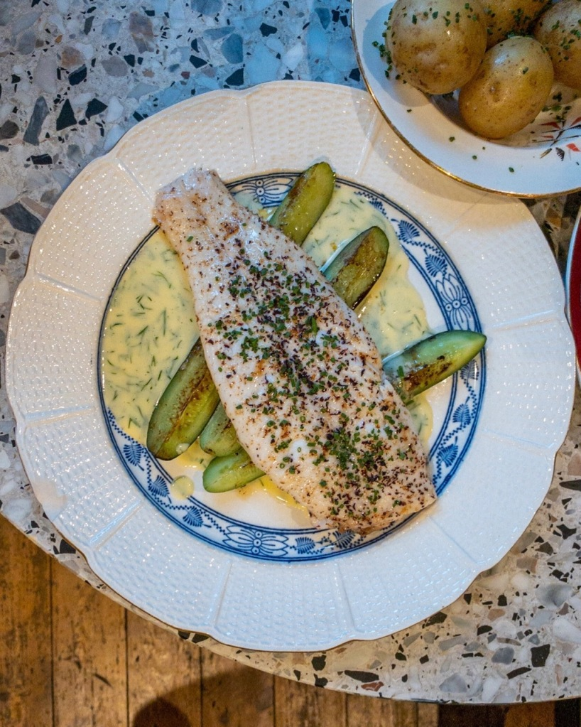 Top down photo of Lemon Sole, Grilled Cucumber and Dill Butter Sauce