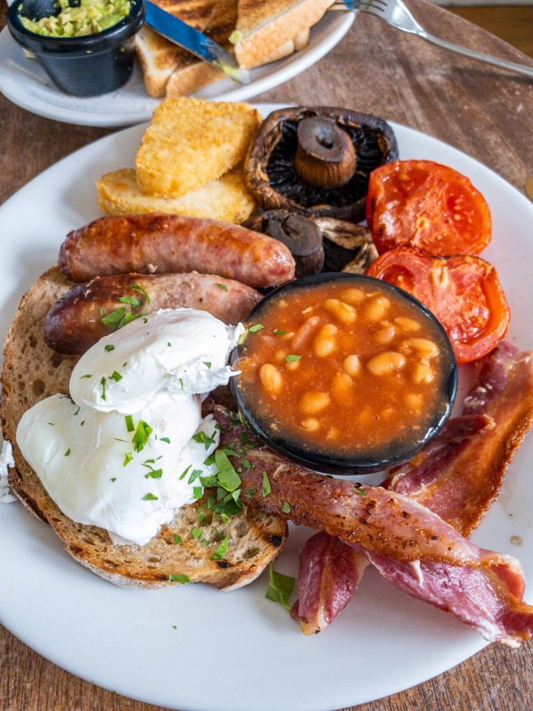 cooked english breakfast - poached eggs, bacon baked beans grilled tomato grilled mushroom hash brown sausages bread